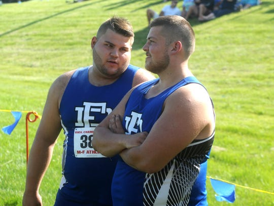 Fort Defiance's Zach Boyers, left, talks with teammate