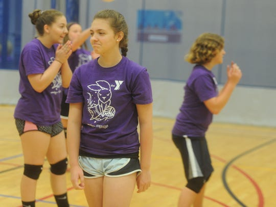 Allie Lopez, 13, reacts to a poor hit during volleyball