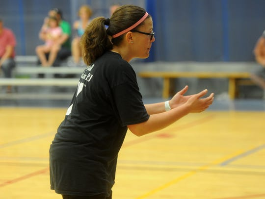 Priscilla Jenkins encourages her players during a volleyball