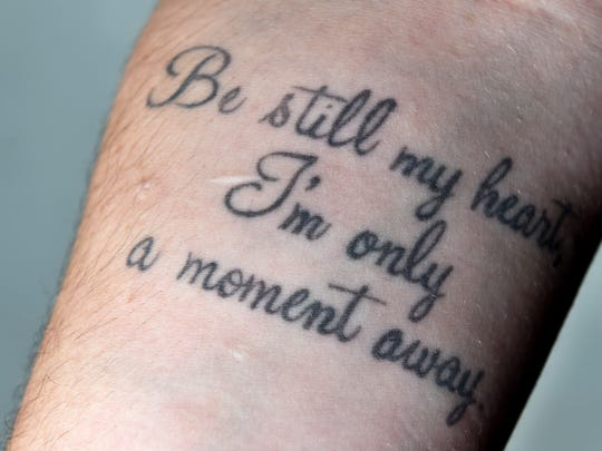 "Laura Peters has the words, ""Be still my heart, I'm only a moment away"" tattooed on her arm where she would once cut herself."