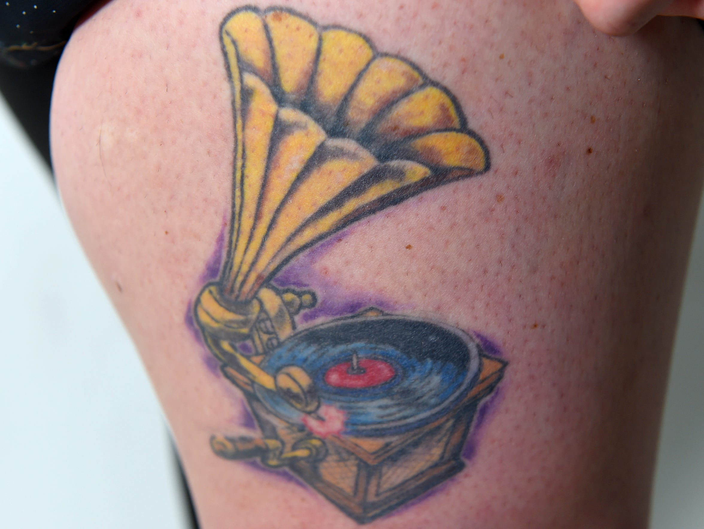 Laura Peters has a tattoo of a phonograph on her upper