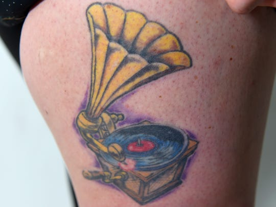 Laura Peters has a tattoo of a phonograph on her upper thigh, representing her love of music. Her thigh was often a spot where she would  harm herself. By putting a tattoo there, it helped her stop and also had a meaning behind it for her.