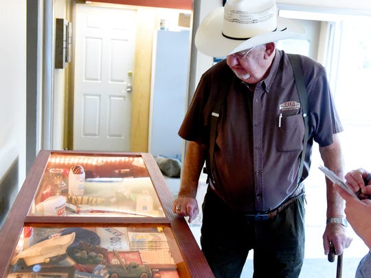 Owner Ray Drumheller looks over a case filled with