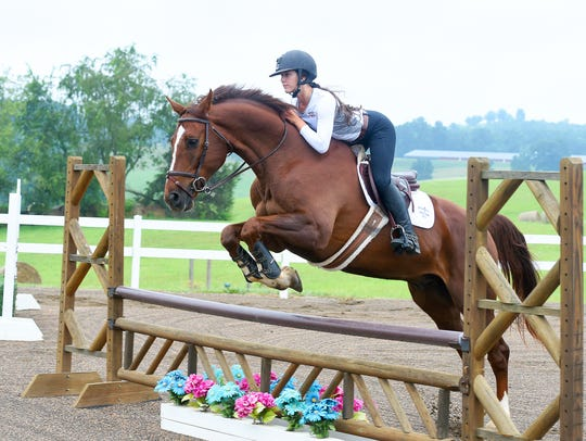 MacKensie Bowles, 17, of Staunton jumps with Chewy,