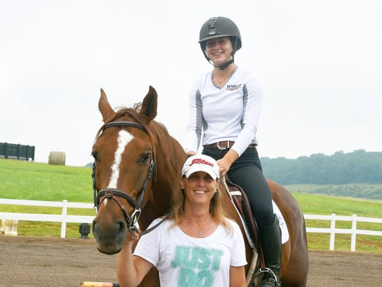MacKensie Bowles, 17, of Staunton is photographed in the saddle astride Chewy, a Zangersheide Warmblood, with her mother, Beth Bowles in Staunton on Wednesday, July 5, 2017.