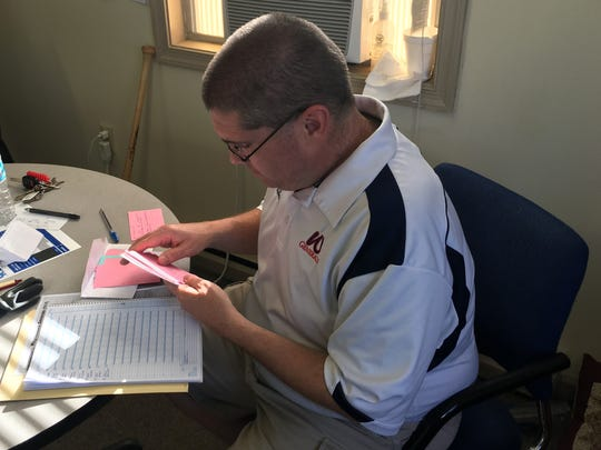 Kris Neil keeps index cards with information on every player in the Valley Baseball League. Before announcing a game, he pulls out the cards for the players involved in that night's contest.