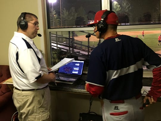 After every home game, Kris Neil, left, interviews