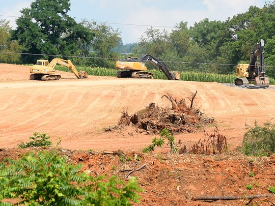 Excavators being used on property where construction