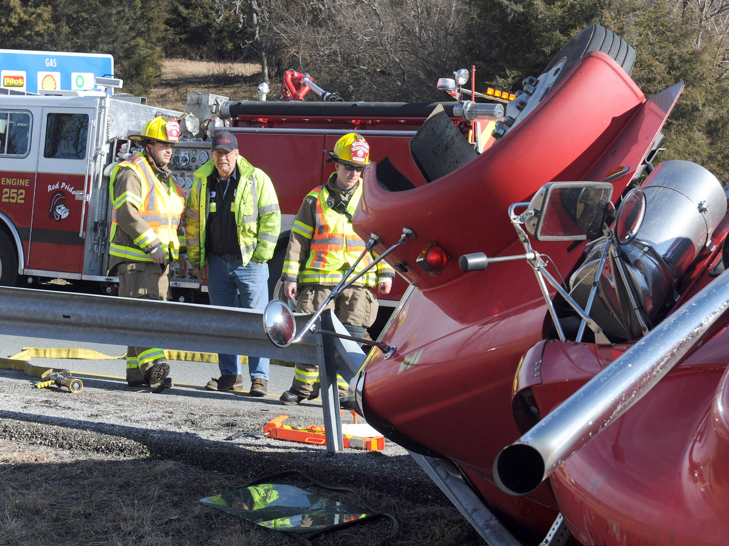 Firefighters with Riverheads Volunteer Fire Department work the scene of an overturned tractor-trailer on I-81 in 2012.
