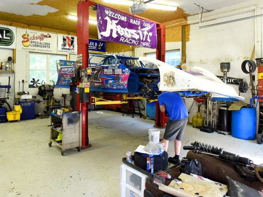 The Rocket XR1 race car Logan Robinson drives is up on a lift as it is worked on in his family's shop in Waynesboro on Wednesday, July 19, 2017. Roberson has been racing since he was 16.