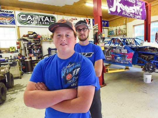 Logan Roberson is photographed with Team manager and crew chief Trevor Cash behind him in a shop in Waynesboro on Wednesday, July 19, 2017. Together, they stand near the Rocket XR1 race car Roberson races.  Roberson has been racing since he was 16.