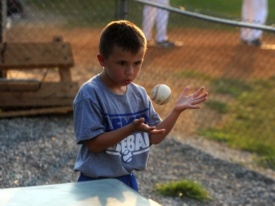 Ethan Carper, 6, plays with a ball while waiting for Wednesday's VBL game between Staunton and Covington to start.