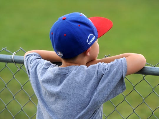 Ethan Carper, 6, watches as Staunton players warm up at Moxie Memorial Stadium before the start of a Valley Baseball League game Wednesday night.