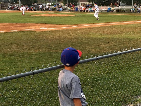 Ethan Carper, 6, watches as the Staunton Braves players