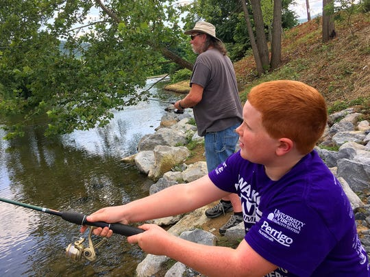 Larry Lilly of Waynesboro fishes with his grandson, Logan Knight, on the South River at Constitution Park in Waynesboro on Monday, July 31, 2017.
