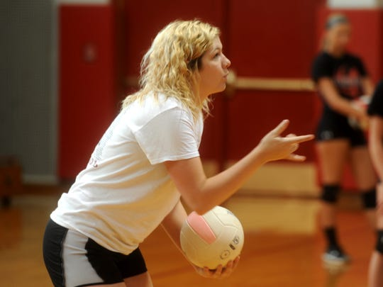 Riverheads volleyball coach Nyssa Stapleton goes over a drill with her players during the first day of practice Monday. Stapleton was named head coach less than a week before tryouts.