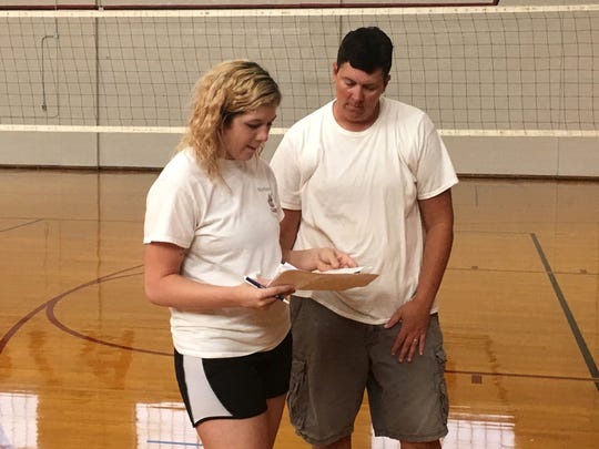 Nyssa Stapleton, left, and Lisa Morris talk before the first day of volleyball practice Monday afternoon at Riverheads High School. Stapleton is the head varsity coach, while Morris is taking over the jayvee program.