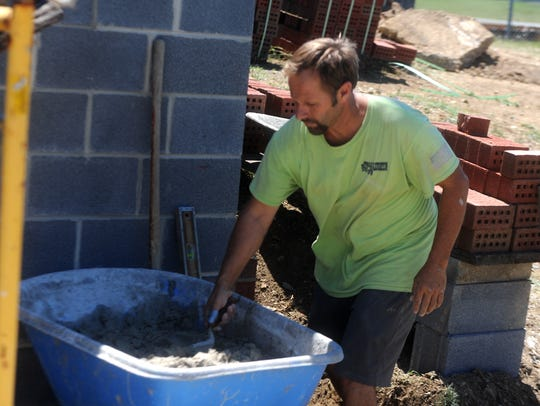 Duane Rothgeb has used his masonry skills to help with