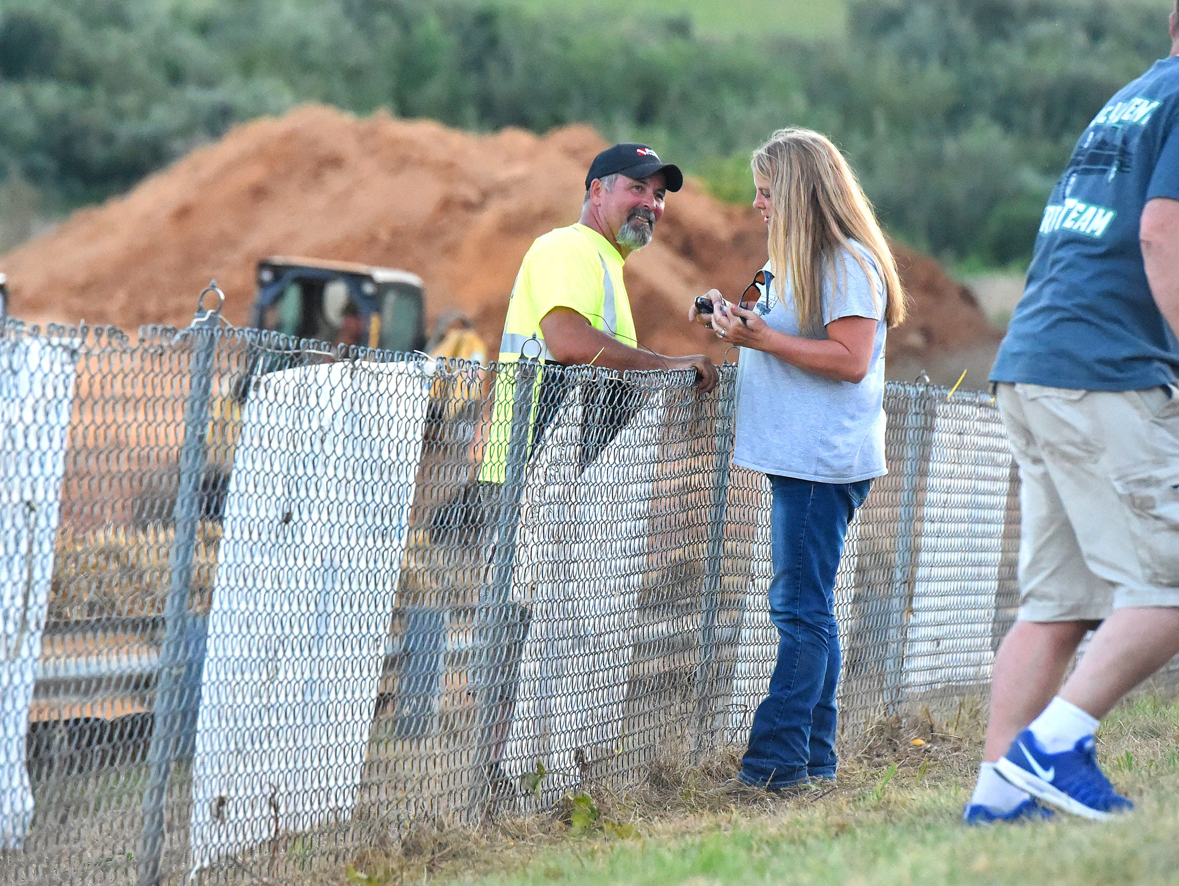 John Breeden of New Hope talks over the track fence