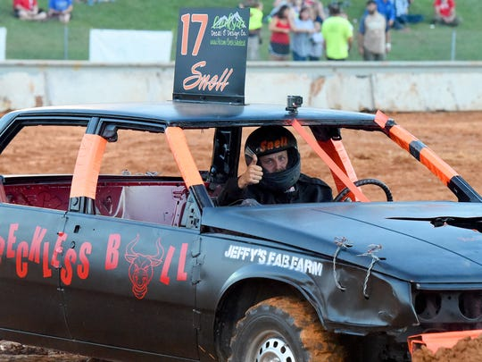 Ronnie Snell gives a thumbs up as he waits for the six-cylinder division of the demolition derby to begin at the Augusta County Fair  on August 3, 2017.