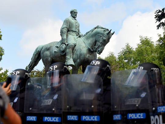A statue of Robert E. Lee seems to stand silently behind