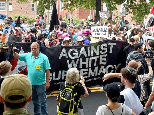 Counter protesters face-off against white nationalists.