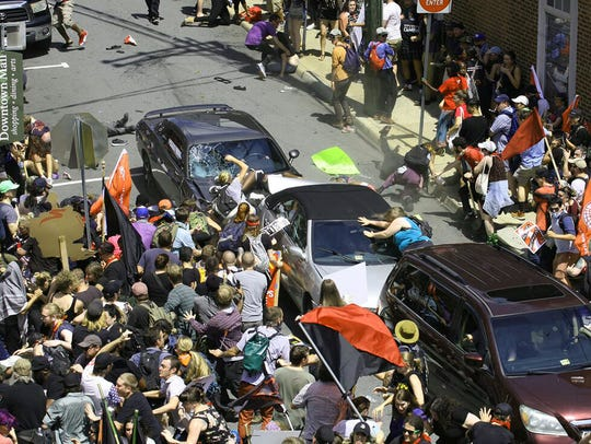 A car is driven into a group of counter protesters,