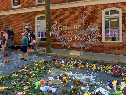 Flowers and words are left along 4th Street in remembrance of Heather Heyer near where she was killed. A memorial service for her was head at the Paramount Theater in Charlottesville on Wednesday, Aug. 16, 2017. Heather was killed by a car driven into a group of protesters Saturday.