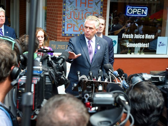 Gov. Terry McAuliffe speaks with members of the media on the mall following a memorial service for Heather Heyer was held at the Paramount Theater in Charlottesville on Wednesday, Aug. 16, 2017. Heather was killed by a car driven into a group of protesters Saturday.