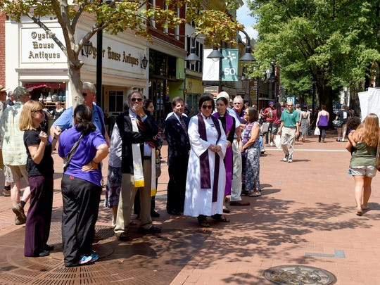 Members of the clergy stood outside on the Mall near Paramount Theater as a memorial service for Heather Heyer was held inside the theater in Charlottesville on Wednesday, Aug. 16, 2017. Heather was killed by a car driven into a group of protesters Saturday.