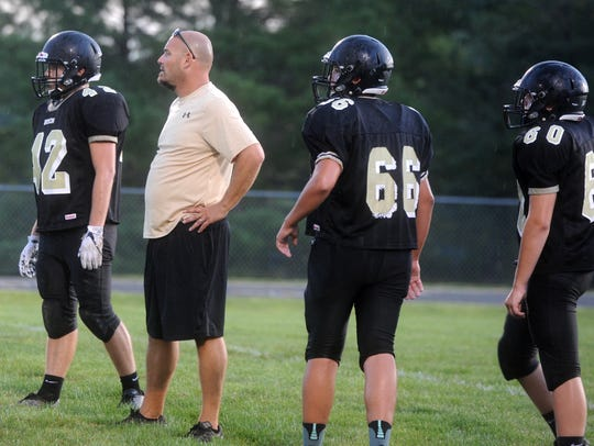 Buffalo Gap coach Andy Cline stands with some of his