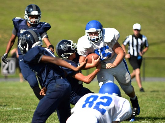 Fort Defiance's Dravon Bowman looks for some running