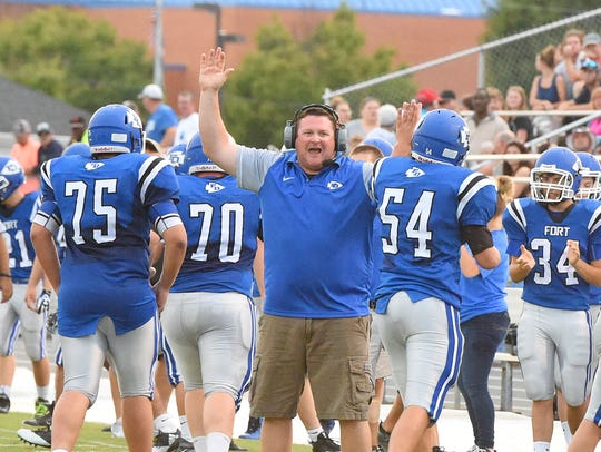 Fort Defiance celebrates a touchdown during a football
