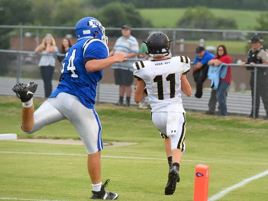 Buffalo Gap's Josh Reed makes it into the end zone for a touchdown before Fort Defiance's Travis Robertson can stop him during a football game played in Fort Defiance on Friday, August 25, 2017.