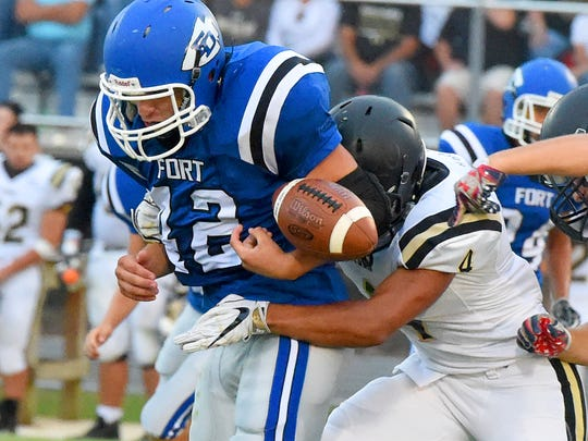 Fort Defiance's Dalton Ream loses the football as he is wrapped up from behind by Buffalo Gap's Jay Johnson during a football game played in Fort Defiance on Friday, August 25, 2017. The ball was recovered by Buffalo Gap.