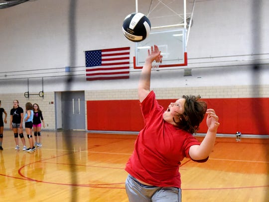 Seventh-grader Amelia Hicks hits the ball as the team performs drills during practice at Shelburne Middle School on Tuesday, Aug. 29, 2017.