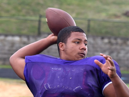 Waynesboro quarterback DaJuan Moore warms up at the start of team practice on Wednesday, Aug. 30, 2017.