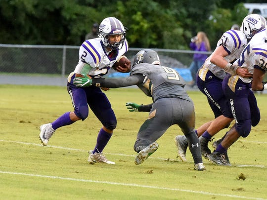 Waynesboro's Tyler Cabell looks for a way around Wilson