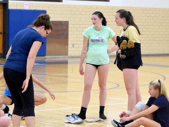 Alyx Steitz, 17, stands with teammates at the end of varsity team volleyball practice at Robert E. Lee High School on Aug. 30, 2017.
