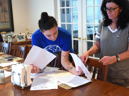 Alyx Steitz, 17, looks with her mother, Mary Thornton, over letters and other papers related to her sexual assault, during an interview in their family home in Staunton on Aug. 30, 2017.