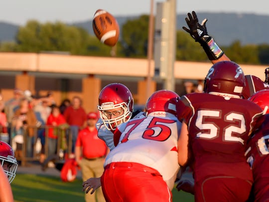 Riverheads' Peyton Skillman is visible as he kicks the ball to put his team on the scoreboard with 3 points with a field goal during a football game played in Stuarts Draft on Friday, Sept. 8, 2017.