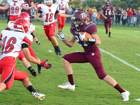 Colby Phillips, right, had a first-half-touchdown Friday night in Stuarts Draft's 42-0 win over Wilson Memorial.