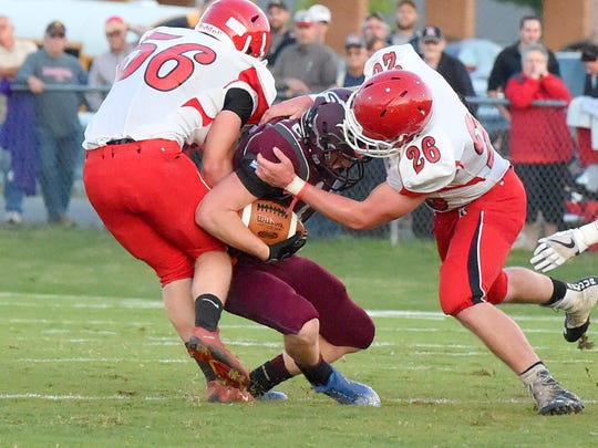 Stuarts Draft's Areian Sanders founds himself caught between Riverheads' Alex Diehl and Dalton Jordan as he has the ball during a football game played in Stuarts Draft on Friday, Sept. 8, 2017.