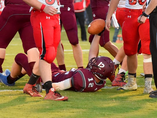 Stuarts Draft's Areian Sanders holds the ball up as he comes up inches short of the goal line during a football game played in Stuarts Draft on Friday, Sept. 8, 2017.