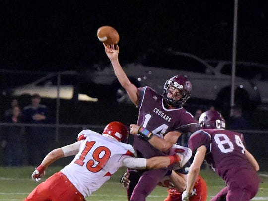 Stuarts Draft quarterback Trevor Craig fires off a pass in the the final seconds of a football game played in Stuarts Draft on Friday, Sept. 8, 2017.