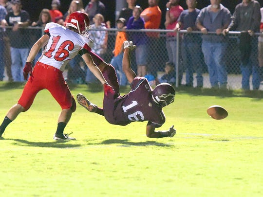 Stuarts Draft's Trevor Craig goes down alongside Riverheads' Andrew Straley after missing a pass in the end zone during the second to final play of a football game played in Stuarts Draft on Friday, Sept. 8, 2017.