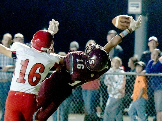 Stuarts Draft's Xzavier Gunn reaches back as he goes up, trying to snag a pass in the end zone but it slips away as Riverheads' Andrew Straley is there during the second to final play of a football game played in Stuarts Draft on Friday, Sept. 8, 2017.