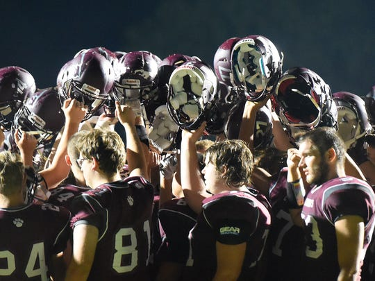 Stuarts Draft players come together and touch helmets after their game against Riverheads played in Stuarts Draft on Friday, Sept. 8, 2017.