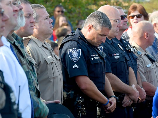 "First responders join others in observing a moment of silence, remembering the attacks of Sept. 11, 2001. Students at Clymore Elementary invited first responders, active military and veterans to join them and students from Fort Defiance High School and Stewart Middle to honor them for the school's annual ""National Anthem Day"" on Sept. 11, 2017."