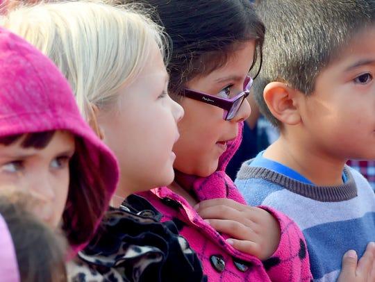 Kindergartener Paulina Cortes has hand over her heart